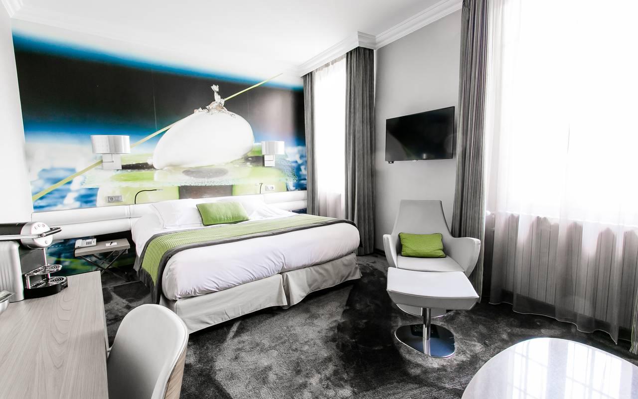 Chambre au style moderne hôtel de luxe Dijon